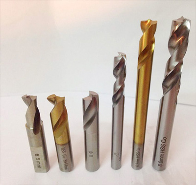 How are commonly used bits for machining produced?